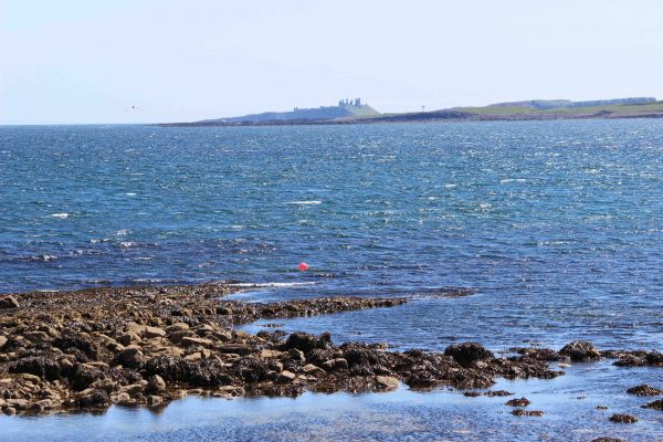 1 Smugglers Cove, view of Dunstanburgh Castle from harbour
