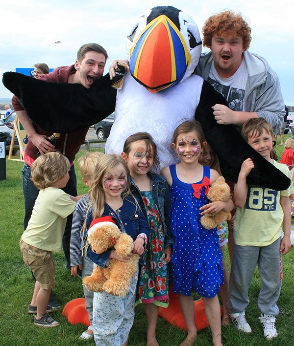 Young people with Tommy Noddy the puffin