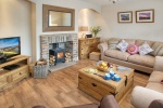 Relax in this cosy lounge with log burning stove is near Bamburgh Castle