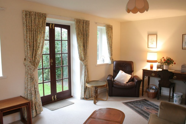 Appletree cottage living room is near The Duke of Wellington Inn