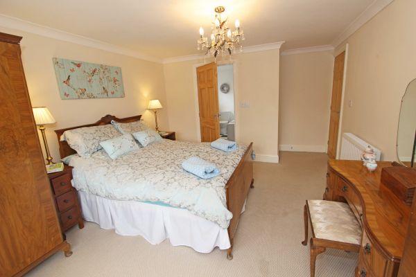 Beachcombers Retreat,master bedroom with en-suite shower room
