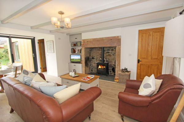 Bridge End Cottage, Rothbury, cosy lounge with log burner