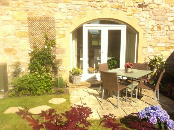Outdoor dining terrace at Causeway Barn
