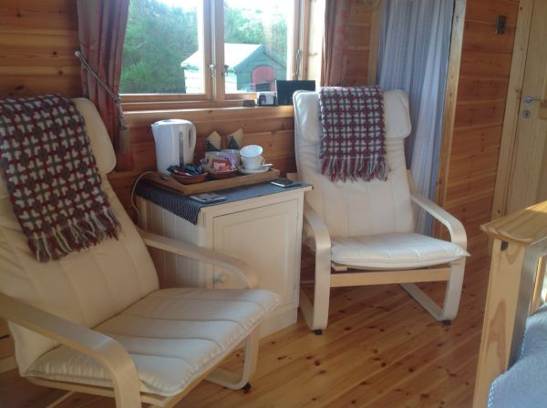 Cabin chairs and fridge