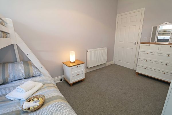 Charles Dickens House, Alnmouth - double bed with single bed overhead
