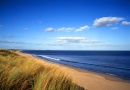 Druridge Bay Country Park is near Poppy Cottage at Hemscott Hill Farm