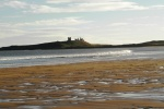 Dunstanburgh Castle, an icon of the Northumberland Coast is near Outchester & Ross Farm Cottages