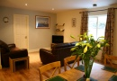 Dining area and living room in Greenleaf is near Seahouses Tourist Information Centre