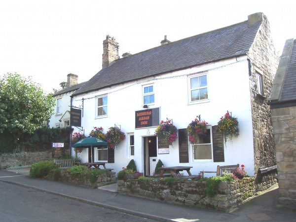 Outside Miners Arms Inn is near Coachmans and Stable Cottages