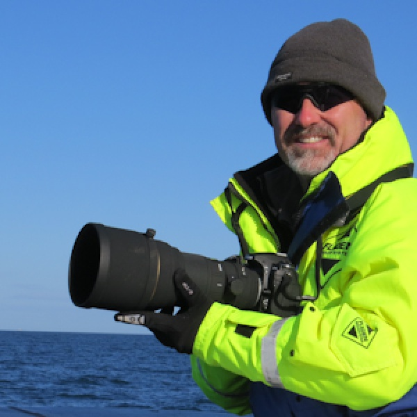 Northern Experience Guide Martin Kitching, on a day searching for dolphins