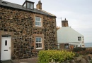 Outside Pegasus Cottage is near Seahouses Tourist Information Centre