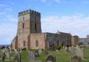 Outside St Aidans in Bamburgh is near Meadowhead's Waren Caravan and Camping Park