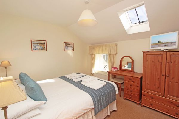 The Mill House, double bedroom with flat screen TV
