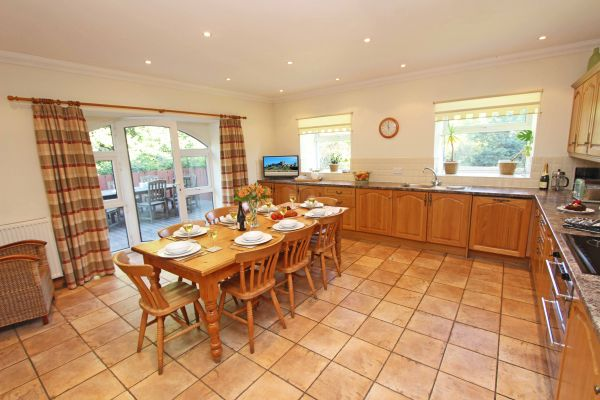 The Mill House, spacious kitchen area with double doors out onto decked area