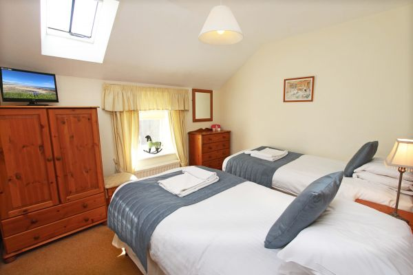 The Mill House, twin bedroom with flat screen TV