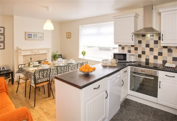 Kitchen and dining area with real open fire