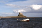 AS GOSPELS RETURN HOME TO DURHAM, LINDISFARNE  VILLAGE CALLS FOR HELP FROM ISLAND VISITORS