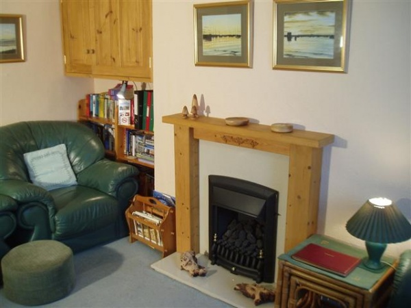 Living room at Amble Cottages is near St Cuthberts Cross