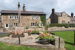 Front of Cottage is near Wooler Tourist Information Centre