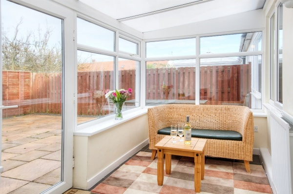 Conservatory with X Box and Flatscreen TV