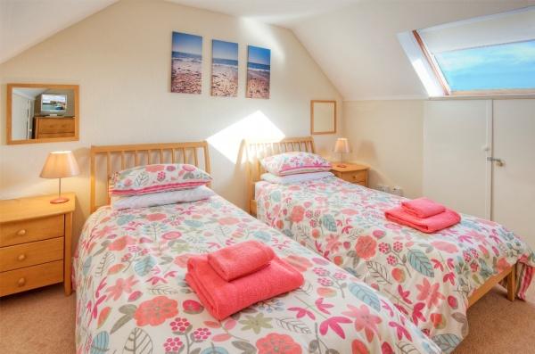 Twin bedroom with flatscreen TV/DVD player
