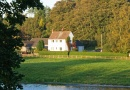 Boathouse cottage and river is near Ford & Etal Estates with Heatherslaw Light Railway