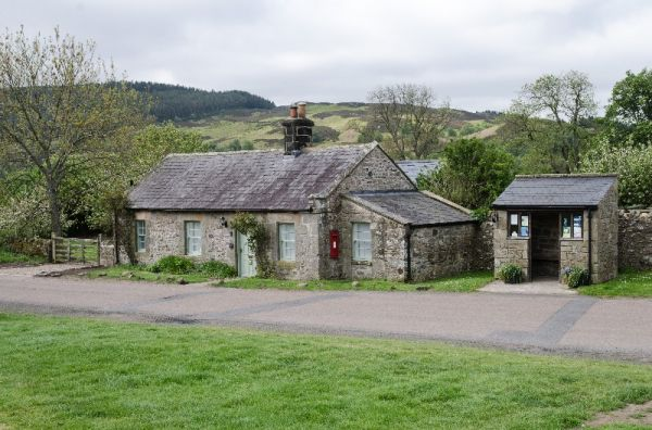 Bridge End Cottage, Rothbury, view of cottage with hills in the background