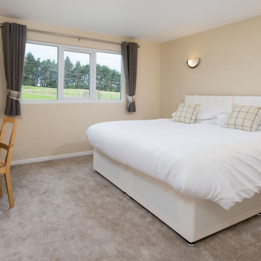 Zip and link beds in one of the twin bedrooms in Tyne