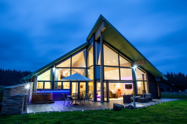 Straker Chalet at dusk is near Kielder Waterside Tipi Weddings