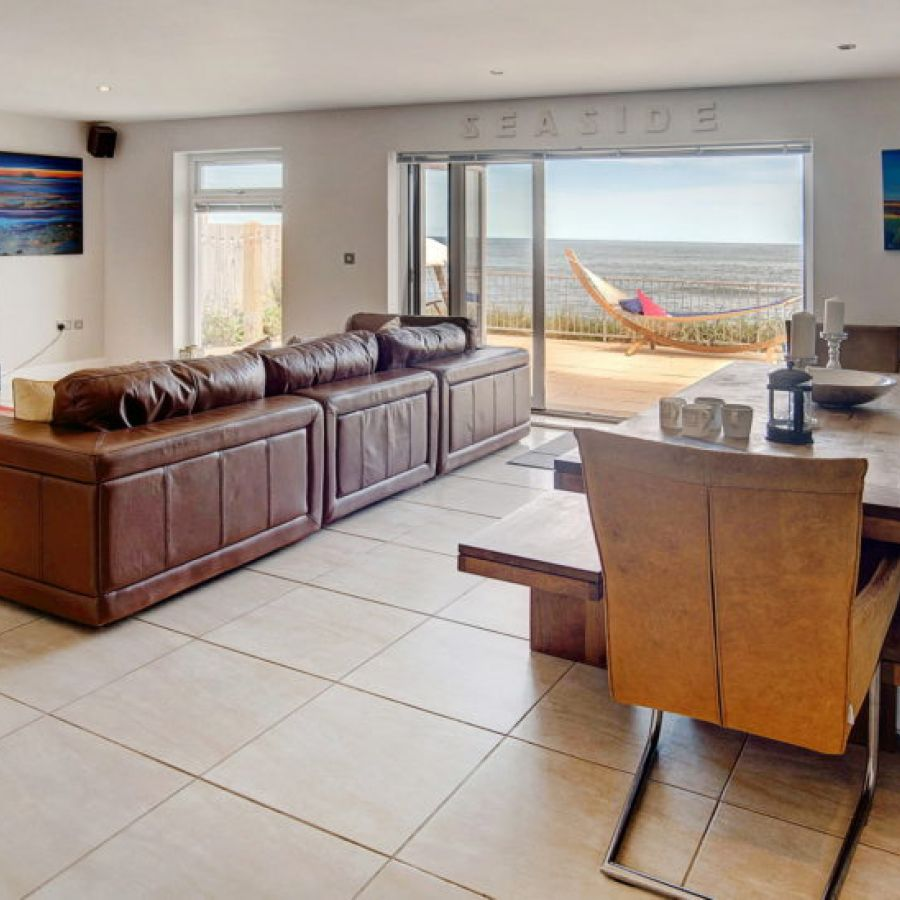 Beadnell Beach House living space and balcony with sea views