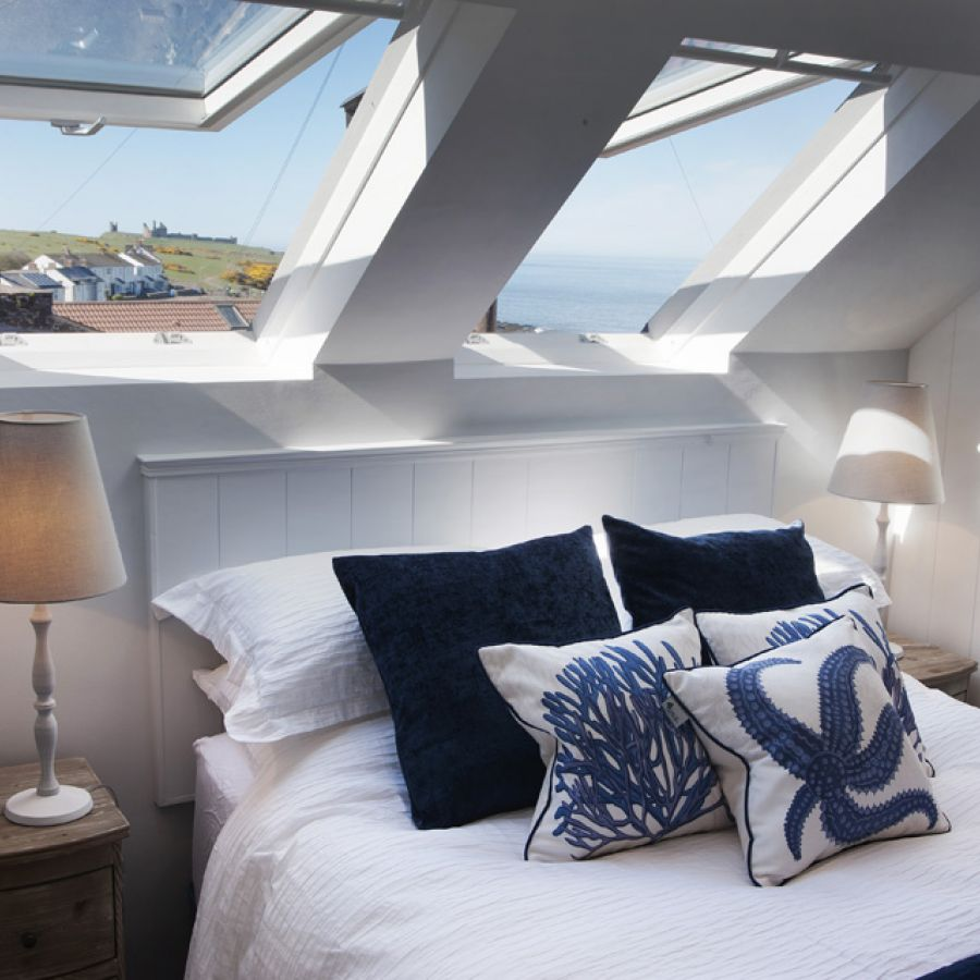 The Arch master bedroom overlooking Dunstanburgh Castle and the coast