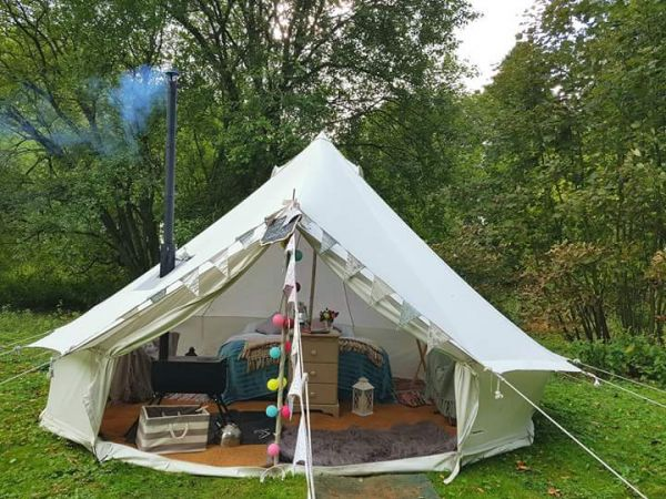 Fully furnished bell tents sleeping up to 2 adults and 2 children