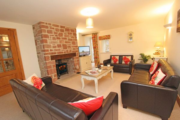 Dolphin Dream, cosy lounge with wood burning stove