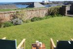 Fisherman'c Cottage view from the garden is near Dunstanburgh Castle
