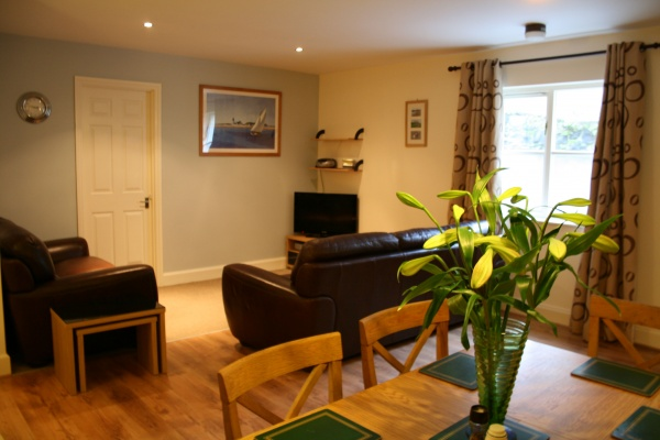 Dining area and living room in Greenleaf is near Billy Shiel Farne Islands Boat Trips