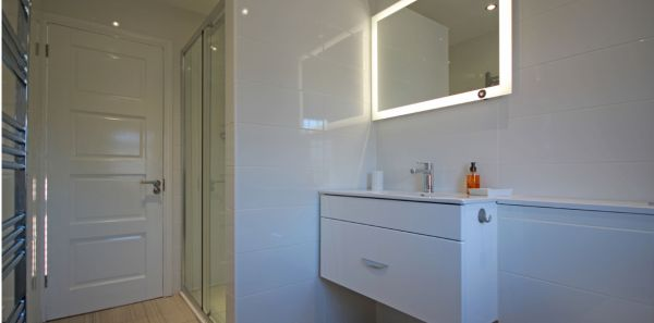 Modern bathroom with shower over the bath