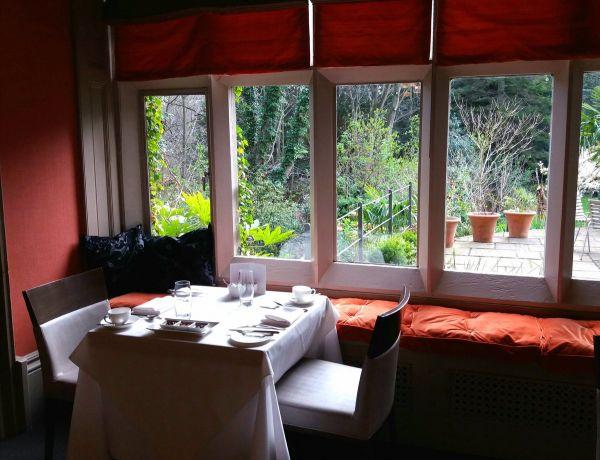 Restaurant table overlooking the garden