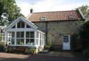 Outside Lesbury Glebe Cottage is near Alnmouth Golf Club