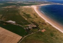 Aerial view of Link House Farm is near Dunstanburgh Castle