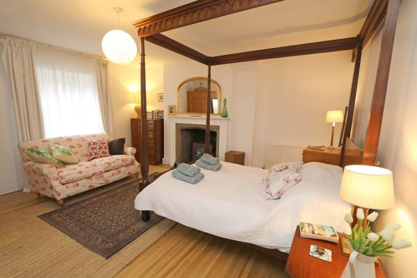 Mariners House, Alnmouth - double bedroom with feature fireplace