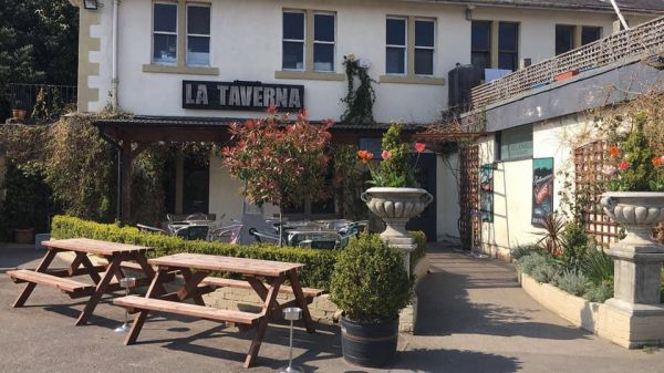 La Taverna Entrance is near Bradley Gardens