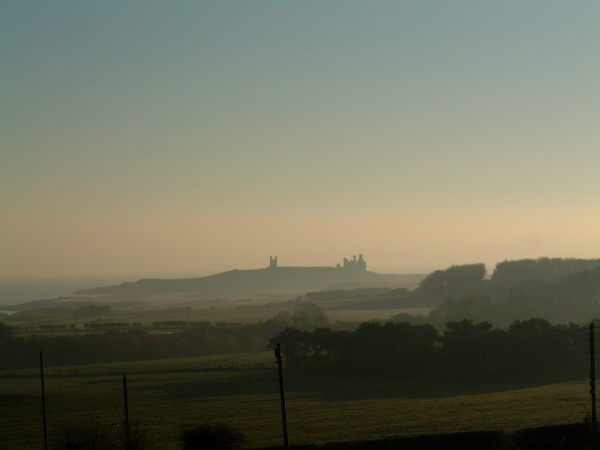 Dunstanburgh Castle taken from the balcony at Upabove