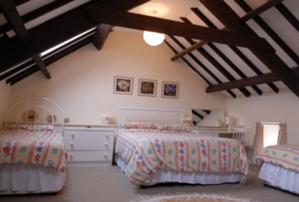 Bedroom with ceiling beams