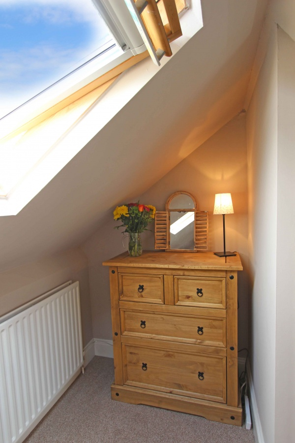 2nd bedroom -lots of natural light with velux windows front and back