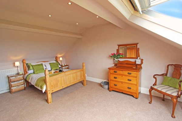 Master bedroom with large velux window fabulous views of Coquet Island and coastline