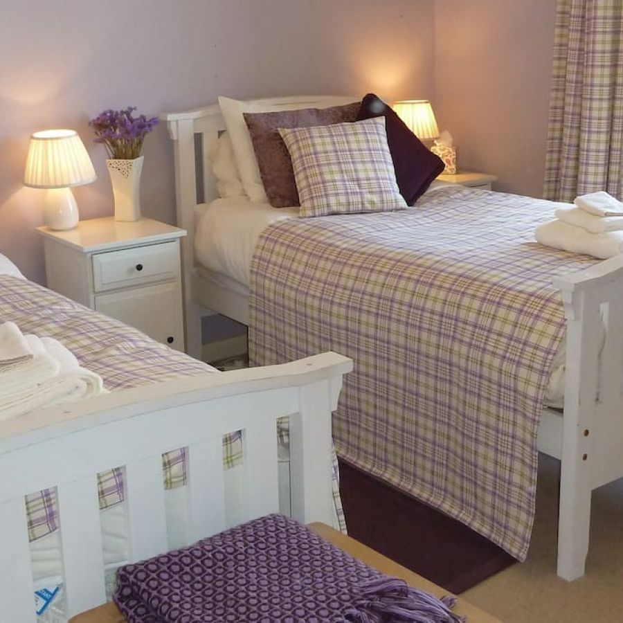 Twin beds in pretty lilac double room