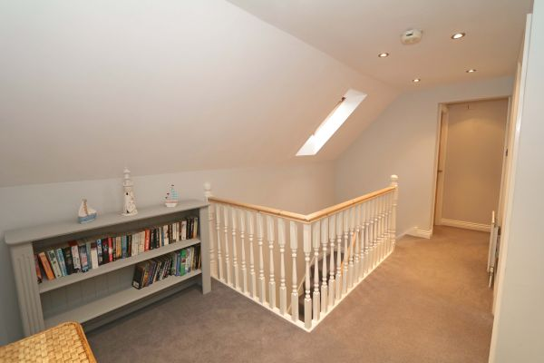 Quarry Haven, Bamburgh, upstairs landing with bookcase
