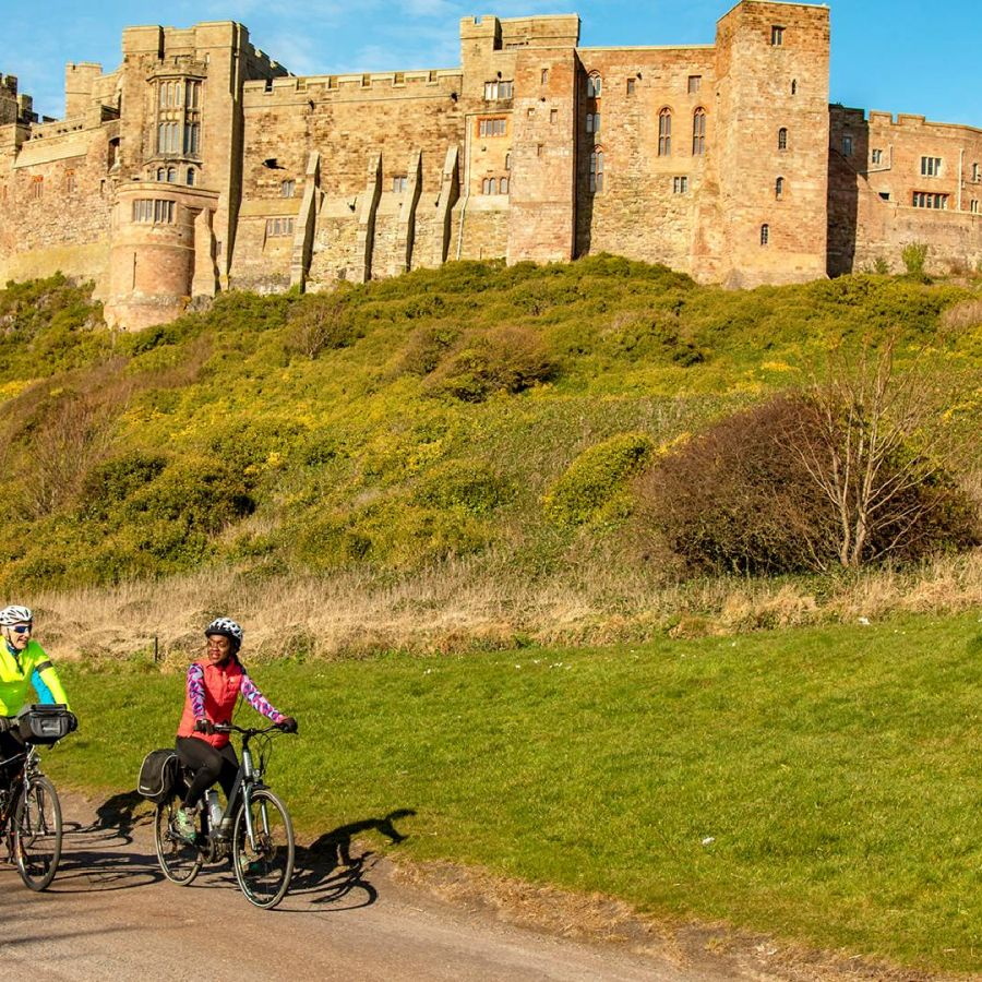 Cyclists at Bamburgh Castle