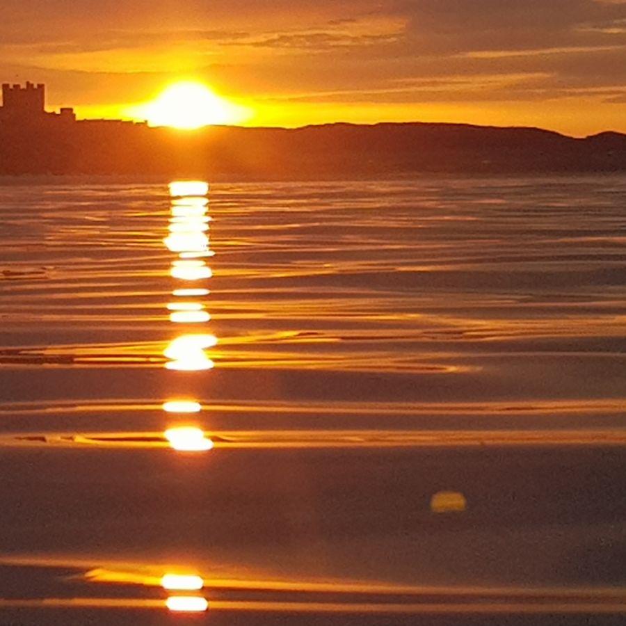 Sunset behind Bamburgh Castle