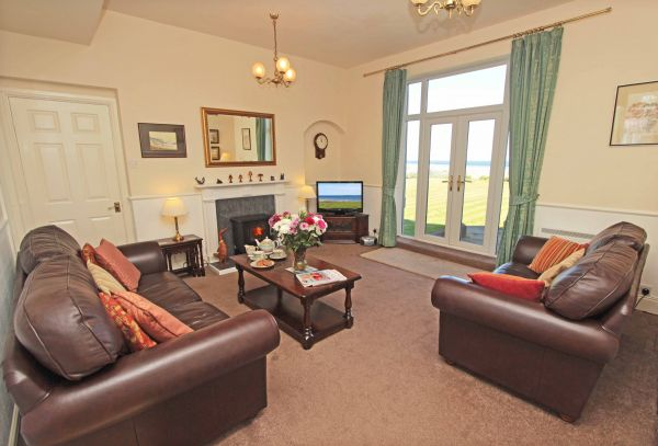 Sound of the Sea, cosy lounge area with lovely coastal views
